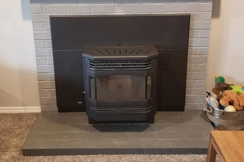 Pellet Stove with White Brick Surround